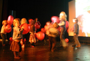 Kids, balloons and dancing on stage