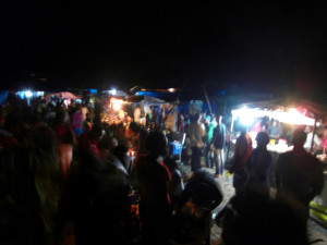 one of the shopping streets at night in the same tent city