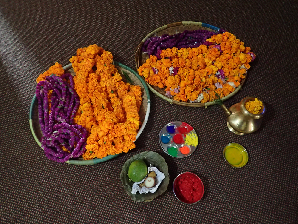 Malas and the tray of tika colours ready for the ceremony