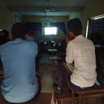 Small screening in a classroom at Khahare School