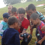 Alex showing the kids their pictures