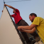 Alex & Dave fixing the tension on the screen - no stepladder now so we improvised with the jeep roof!