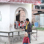 Children playing on a shrine in Libali